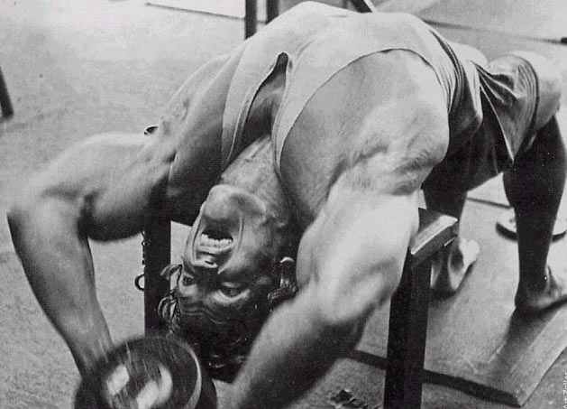Arnold performing the dumbbell pullover.